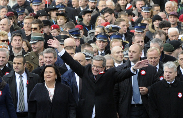 Polish President Bronislaw Komorowski, centre, greets people, as he and wife Anna, second left, open the March For Independent Poland, during a ceremony marking Independence Day,  in Warsaw, Poland, S