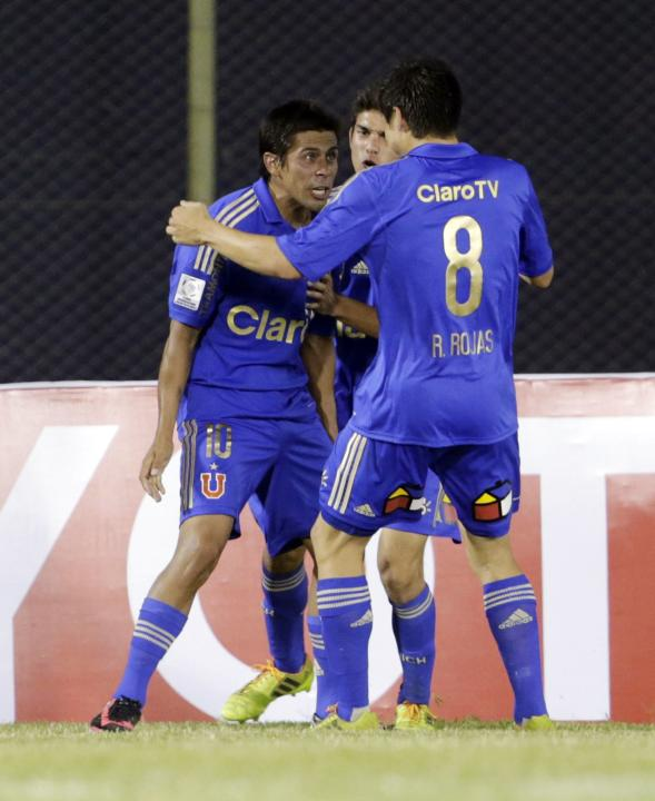 Ramon Ignacio Fernandez of Universidad de Chile celebrates a goal against Paraguay's Guarani with teammate Rodrigo Rojas during their Copa Libertadores soccer match in Asuncion