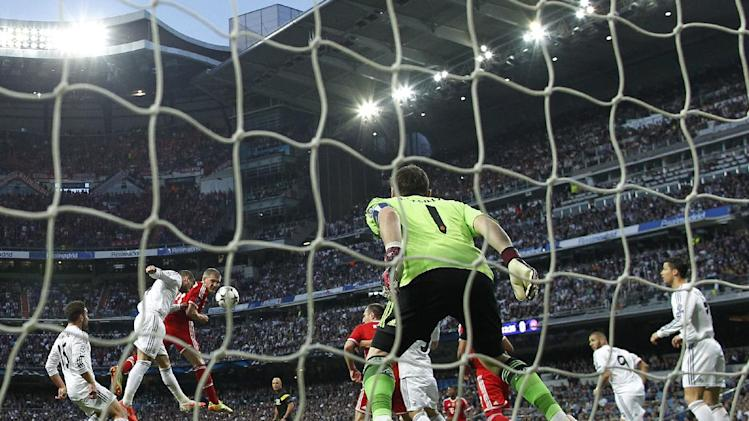 Bayern's Bastian Schweinsteiger, third left, in action with Real's Sergio Ramos, second left, during a first leg semifinal Champions League soccer match between Real Madrid and Bayern Munich at the Santiago Bernabeu stadium in Madrid, Spain, Wednesday, April 23, 2014