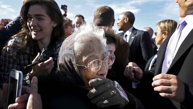 Founding member of the Fairbanks Native Association Carlo wipes away a tear after meeting U.S. President Obama after he arrived aboard Air Force One at Elmendorf Air Force Base in Anchorage, Alaska
