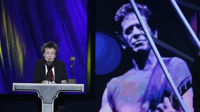 Laurie Anderson accepts for Lou Reed at the Rock and Roll Hall of Fame Induction Ceremony Saturday, April 18, 2015, in Cleveland. (AP Photo/Mark Duncan)