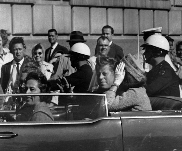 FILE - This Nov. 22, 1963 file photo shows President John F. Kennedy riding in motorcade with first lady Jacqueline Kenndy before he was shot in Dallas, Texas. The Sept. 11, 2001 terrorist attack is b