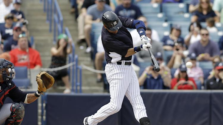 New York Yankees' Derek Jeter connects for a first-inning single against the Atlanta Braves in his first at-bat in a spring training baseball game since breaking an ankle during the 2012 playoffs, at Steinbrenner Field in Tampa, Fla., Saturday, March 9, 2013.  (AP Photo/Kathy Willens)