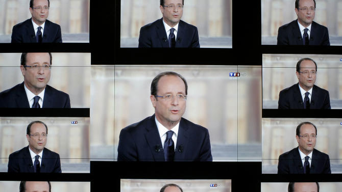 """Socialist Party candidate for the presidential election Francois Hollande, is seen on a wall screen during the televised debate with  President and conservative rival Nicolas Sarkozy, at the TF1 television studio, in Boulogne-Billancourt, outside Paris, Wednesday, May 2, 2012. The prime-time debate between conservative incumbent Sarkozy and his leftist challenger Hollande is billed in newspaper headlines Wednesday as """"The Last Duel"""" and """"The Final Confrontation,"""" providing a sense of suspense in a campaign that, if polls are right, has lacked it from the beginning. (AP Photo/Thibault Camus)"""