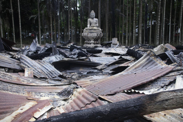 A Buddha statue stands amidts the ruins of a Buddhist temple that was torched in Ramu in the coastal district of Cox&#39;s Bazar, Bangladesh, Sunday, Sept. 30, 2012. Thousands of Bangladeshi Muslims angry over an alleged derogatory photo of the Islamic holy book Quran on Facebook set fires in at least 10 Buddhist temples and 40 homes near the southern border with Myanmar, authorities said Sunday. (AP Photo)