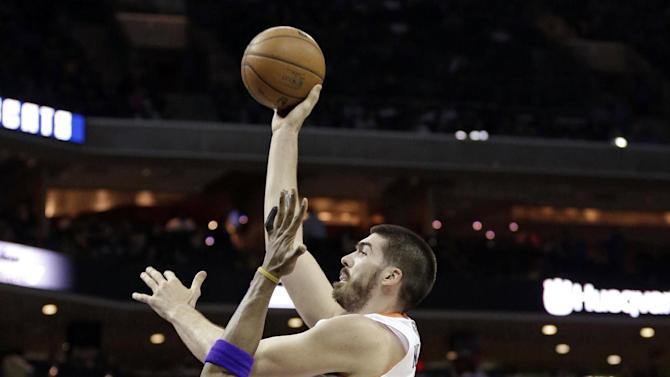 Charlotte Bobcats' Byron Mullens, right, shoots over Los Angeles Lakers' Antawn Jamison, left, during the first half of an NBA basketball game in Charlotte, N.C., Friday, Feb. 8, 2013. (AP Photo/Chuck Burton)