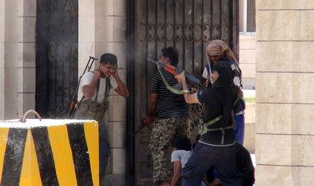 Fighters loyal to Yemen's President Hadi call clash with Houthi fighters outside Hadi's house in the country's southern port city of Aden