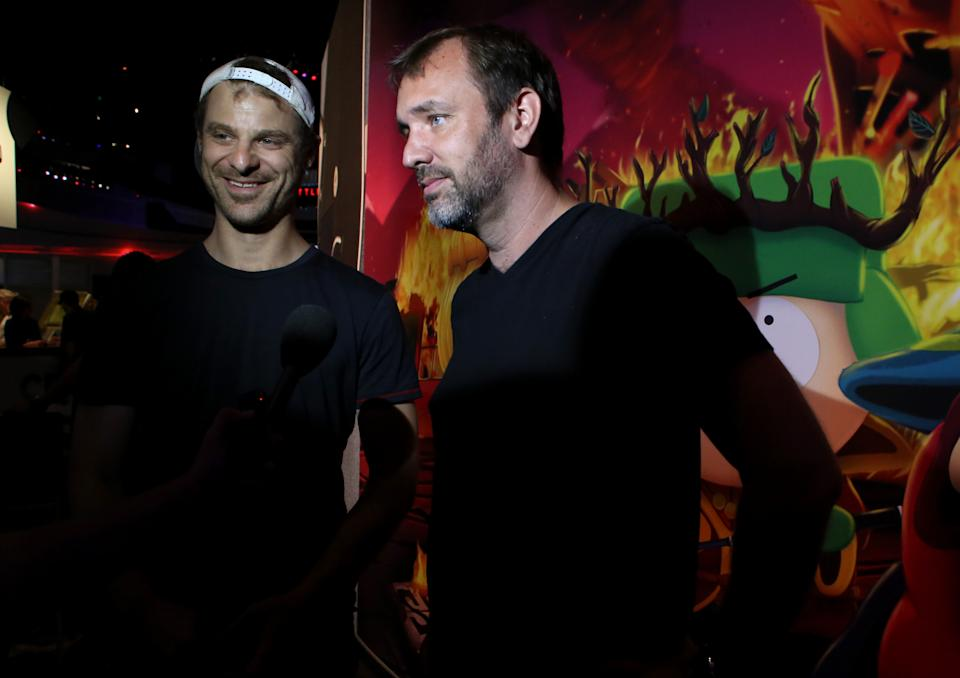 "FILE - This June 12, 2013 file photo released by Ubisoft shows Matt Stone, left, and Trey Parker at the the Ubisoft booth to discuss ""South Park: The Stick of Truth"" at E3 in Los Angeles. (AP Photo/Ubisoft, Alexandra Wyman, file)"