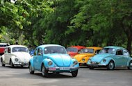 Vintage Volkswagen Beetle cars at a rally in Colombo, Sri Lanka, last month. Volkswagen says net profits in the first half of the year soared by 36% as Europe&#39;s biggest car maker sold 4.6 mn cars worldwide
