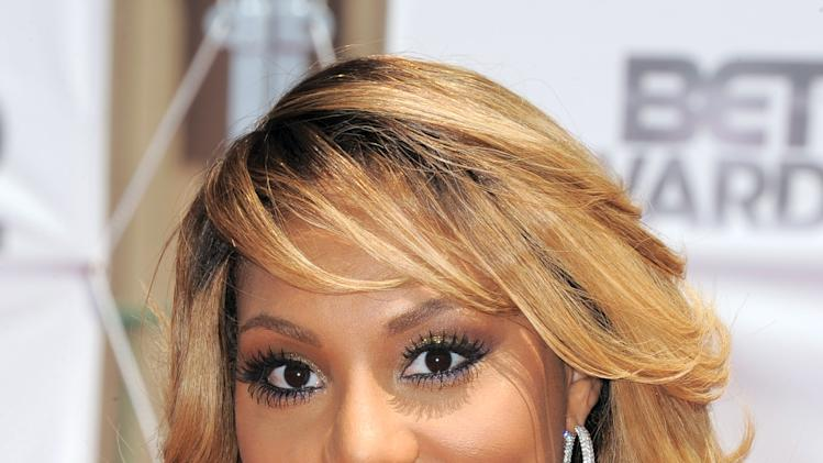 Tamar Braxton arrives at the BET Awards on Sunday, July 1, 2012, in Los Angeles. (Photo by Jordan Strauss/Invision/AP)
