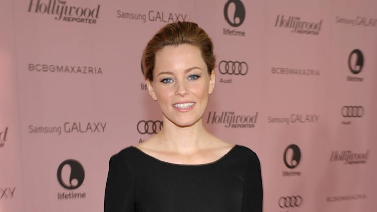 Actress Elizabeth Banks arrives at The Hollywood Reporter's 21st Annual Women in Entertainment Power 100 breakfast presented by Lifetime on Wednesday, Dec. 5, 2012 in Beverly Hills, Calif.  (Photo by John Shearer/Invision for The Hollywood Reporter/AP Images)