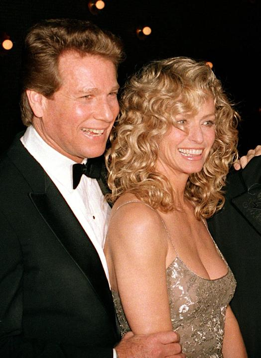 "FILE - This March 5, 1989 file photo shows actors Ryan O'Neal, left, and Farrah Fawcett at the premiere of the film. ""Chances Are,"" in New York. A judge ruled Thursday, Dec. 5, 2013, tha"