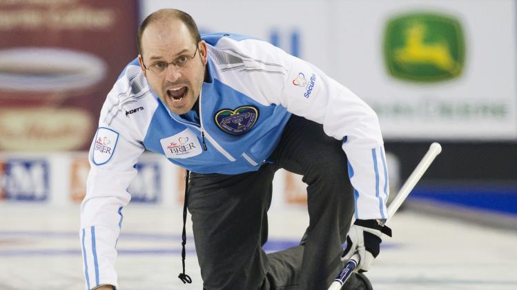 Team Quebec skip Jean-Michel Menard guides a rock in their second end against team Alberta during the semi-final draw at the 2014 Tim Hortons Brier curling championships in Kamloops, British Columbia