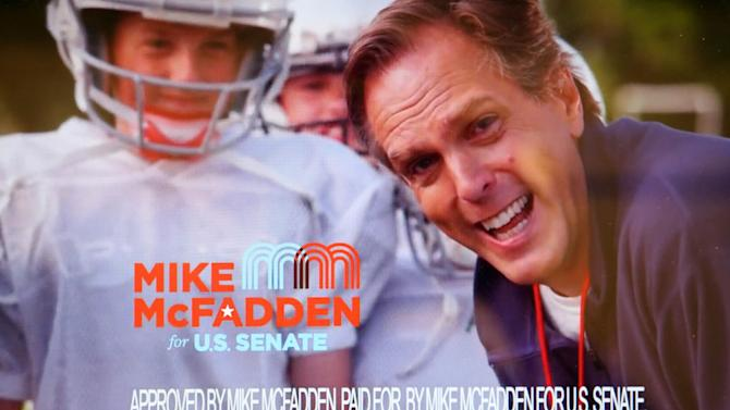 In this image made from video provided by the Mike McFadden for U.S. Senate campaign in 2014, McFadden delivers the standard campaign disclosure in a high-pitched voice after taking a punch from a young football player in his first campaign advertisement. (AP Photo/McFadden Campaign)
