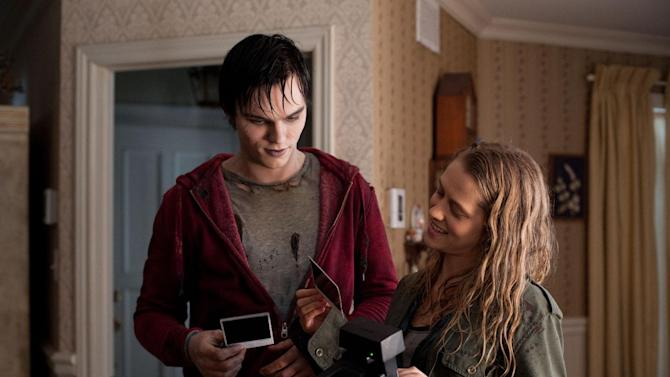 """This film image released by Summit Entertainment shows Nicholas Hoult, left, and Teresa Palmer in a scene from """"Warm Bodies."""" (AP Photo/Summit Entertainment, Jonathan Wenk)"""