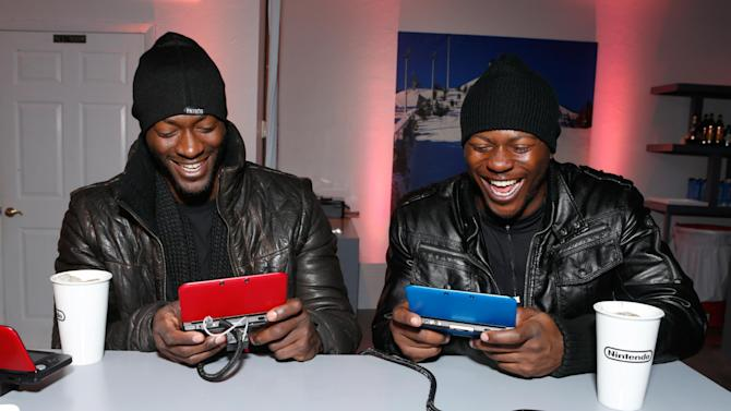 IMAGE DISTRIBUTED FOR NINTENDO -  Actors Aldis Hodge, left, and Edwin Hodge warm up and check out Nintendo 3DSXL at the Nintendo Lounge during a break from the Sundance Film Festival on Friday, January 18, 2013 in Park City, UT. (Photo by Todd Williamson/Invision for Nintendo/AP Images)