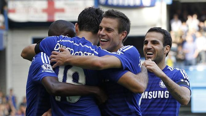 Chelsea's Diego Costa (2nd L) celebrates with Cesar Azpilicueta (2nd R) and Cesc Fabregas (R) after scoring during the Premier League match against Swansea City at Stamford Bridge on September 13, 2014