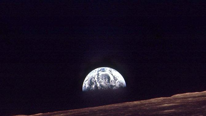 """FILE - In this Dec. 24, 1968 photo provided by NASA, the Earth rises over the horizon of the moon during the Apollo 8 mission. NASA, the agency that epitomized the """"Right Stuff,"""" looks lost in space and doesn't have a clear sense of where it is going, an independent panel of science and engineering experts said in a stinging report Wednesday. (AP Photo/NASA, File)"""