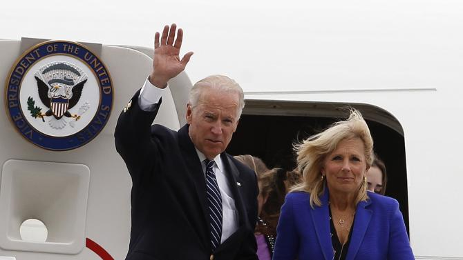 U.S. Vice President Joe Biden, left, accompanied by his wife Jill Biden walks out of Air Force Two upon their arrival to a military airport in Bogota, Colombia, Sunday, May 26, 2013. Biden arrived in Colombia as the first stop of a tour that also includes Brazil and Trinidad and Tobago. (AP Photo/Fernando Vergara)