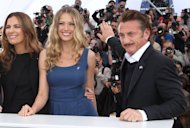 Actress Roberta Armani, left, model Petra Nemcova and actor Sean Penn pose during a photo call for the Haiti Carnival charity event at the 65th international film festival, in Cannes, southern France, Friday, May 18, 2012. (AP Photo/Joel Ryan)