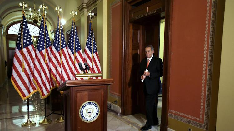 "House Speaker John Boehner of Ohio arrives to speak on the fiscal cliff negotiations on Capitol Hill in Washington, Wednesday, Dec. 19, 2012. Boehner says President Barack Obama should support a Republican plan to avoid January tax increases on everyone but those earning over $1 million. Boehner says if Obama doesn't support the measure, the president will be responsible for what he calls ""the largest tax increase in history.""(AP Photo/Jacquelyn Martin)"