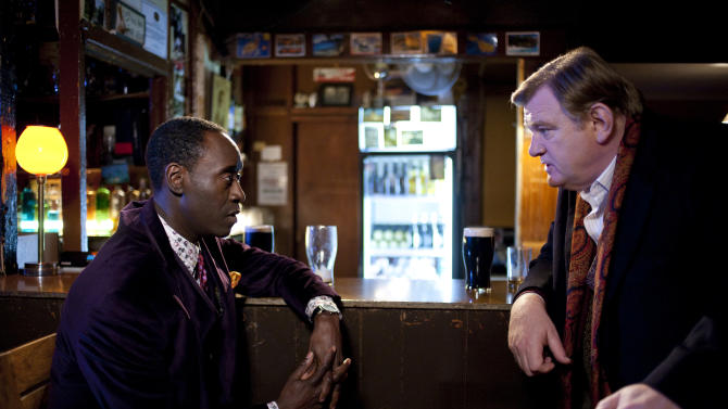 """In this film publicity image released by Sony Pictures Classics, Don Cheadle, left, and Brendan Gleeson is shown in a scene from """"The Guard."""" (AP Photo/Sony Pictures Classics)"""