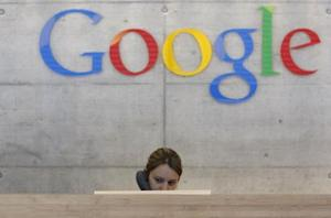 An employee answers phone calls at the switchboard of the Google office in Zurich