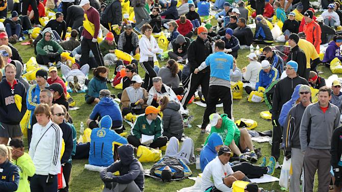 Runners gather at the athletes village prior to the start of the 117th running of the Boston Marathon, in Hopkinton, Mass., Monday, April 15, 2013. (AP Photo/Stew Milne)