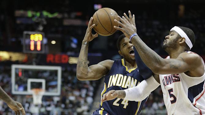 Indiana Pacers small forward Paul George (24) moves the ball against Atlanta Hawks small forward Josh Smith (5) during the first half in Game 4 of their first-round NBA basketball playoff series game, Monday, April 29, 2013 in Atlanta. (AP Photo/John Bazemore)