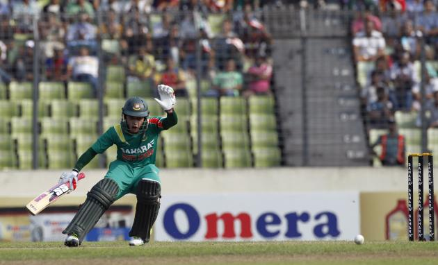 Bangladesh's captain Mushfiqur Rahim runs between the wickets against New Zealand during their first ODI cricket match in Dhaka