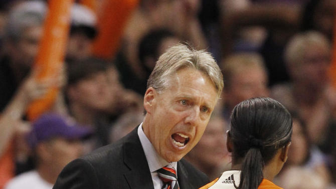 Seattle Storm head coach Brian Agler, left, argues with referee Felicia Grinter during the fourth quarter of a first-round WNBA playoff basketball game against the Phoenix Mercury, Saturday, Sept. 17, 2011, in Phoenix. The Mercury defeated the Storm 92-83. (AP Photo/Ross D. Franklin)