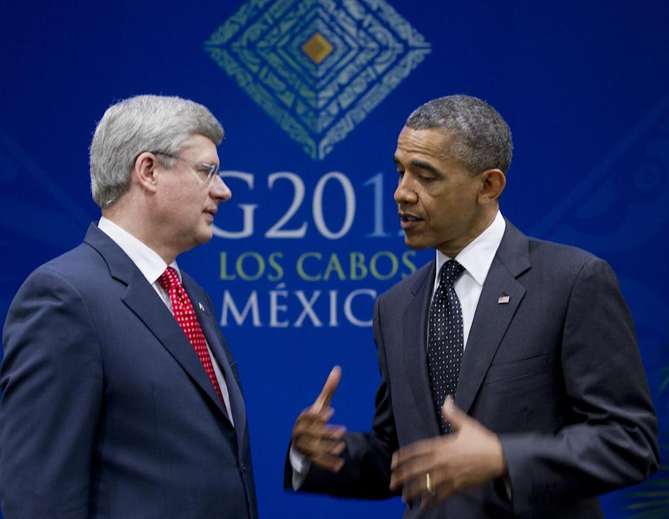 President Barack Obama gestures as he speaks during a bilateral meeting with Canada's Prime Minister Stephen Harper during the G20 Summit, Tuesday, June 19, 2012, in Los Cabos, Mexico. (AP Photo/Carolyn Kaster)