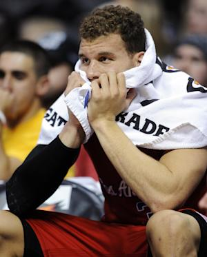 Los Angeles Clippers forward Blake Griffin watches from the bench during an NBA basketball game against the Denver Nuggets, Tuesday, Jan. 1, 2013, in Denver. The Nuggets won 92-78. (AP Photo/Jack Dempsey)