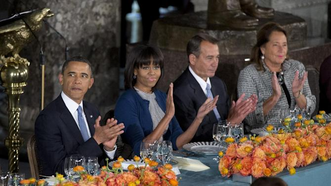 President Barack Obama, from left, with first lady Michelle Obama, Speaker of the House John Boehner, R-Ohio, and his wife Deborah Gunlack, attend a luncheon after his ceremonial swearing-in on Capitol Hill in Washington, Monday, Jan. 21, 2013. (AP Photo/Manuel Balce Ceneta)