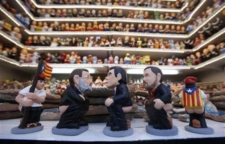 "Clay ""caganers"" representing Spain's Prime Minister Mariano Rajoy, Catalunya's rregional President Artur Mas and ERC leader Oriol Junqueras are displayed in central Barcelona"
