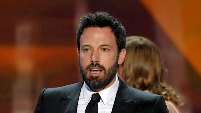 """Ben Affleck accepts the award for outstanding cast in a motion picture for """"Argo"""" at the 19th Annual Screen Actors Guild Awards at the Shrine Auditorium in Los Angeles on Sunday Jan. 27, 2013. (Photo by John Shearer/Invision/AP)"""