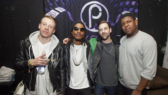 IMAGE DISTRIBUTED FOR PARK CITY LIVE - Macklemore, Owuor Arunga, Ryan Lewis and Ray Dalton backstage at Park City Live Day 9 on Friday, January 25, 2013, in Park City, Utah. (Photo by Barry Brecheisen/Invision for Park City Live/AP Images)