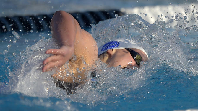 Katie Ledecky swims in the women's 400-meter freestyle final at the U.S. nationals of swimming, Saturday, Aug. 9, 2014, in Irvine, Calif. Ledecky won the race and set a world record. (AP Photo/Mark J. Terrill)