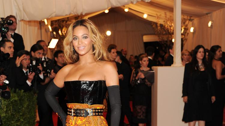 "Beyonce Knowles attends The Metropolitan Museum of Art's Costume Institute benefit celebrating ""PUNK: Chaos to Couture"" on Monday, May 6, 2013, in New York. (Photo by Evan Agostini/Invision/AP)"