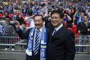 File photo of Cardiff City's Malaysian Chairman Chan Tien Ghee and Malaysian owner Vincent Tan smiling ahead of their English League Cup final soccer match against Liverpool at Wembley Stadium in London