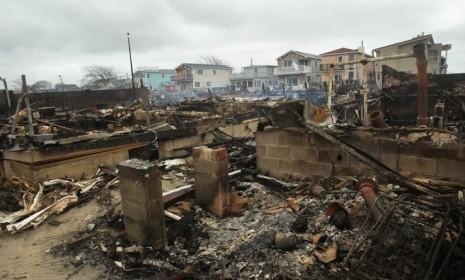 Homes sit smoldering in the Breezy Point neighborhood of Queens, N.Y. Some 100 homes burned down in a fire during the storm.