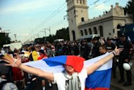 A Russian football fan waves a national flag as he shouts slogans during a march towards the National Stadium of Warsaw on June 13. A festive mood set the tone in Warsaw for a crucial Russia-Greece Euro 2012 face off Saturday, just four days after a Poland-Russia match in the city was marred by the worst fan violence of the championships