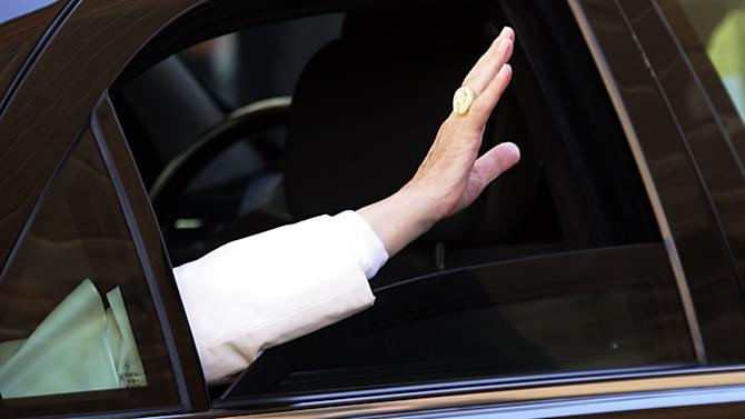 FILE - This Nov. 3, 2006 file photo shows Pope Benedict XVI's hand as he waves to faithful from his car at the end of his visit at the Pontifical Gregorian University in Rome. (AP Photo/Gregorio Borgia, files)