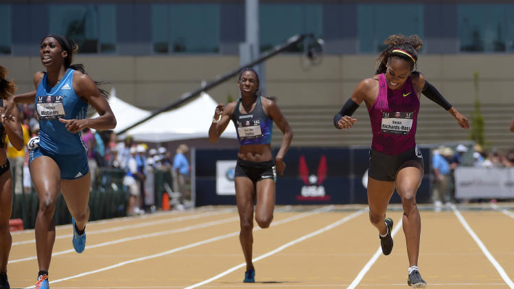 Francena McCorory, left, wins the women's 400 meters ahead of Sanya Richards-Ross, right, and Dee Dee Trotter at the U.S. outdoor track and field championships, Saturday, June 28, 2014, in Sacramento, Calif. Richards-Ross took second in the event. (AP Photo/Mark J. Terrill)