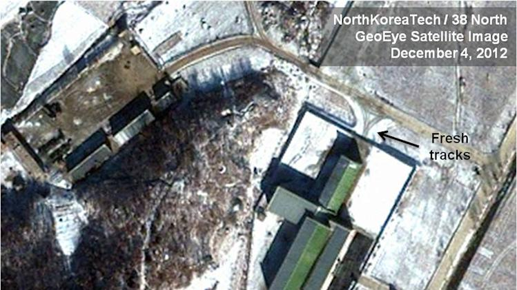 This Dec. 4, 2012 satellite image taken by GeoEye  and annotated and distributed by North Korea Tech and 38 North shows snow covering the Sohae launching station in Tongchang-ri, North Korea, including the path where trailers would be used to move the rocket stages from the assembly building to the launch pad in preparation for a Dec. 10-22 launch. New satellite images show that heavy snowfall may have slowed North Korean rocket launch preparations but that Pyongyang could still be ready for liftoff starting Monday, Dec. 10, 2012. This image was shared with the AP by the 38 North and North Korea Tech websites, which collaborate on analysis of the satellite imagery. (AP Photo/GeoEye via North Korea Tech and 38 North) MANDATORY CREDIT