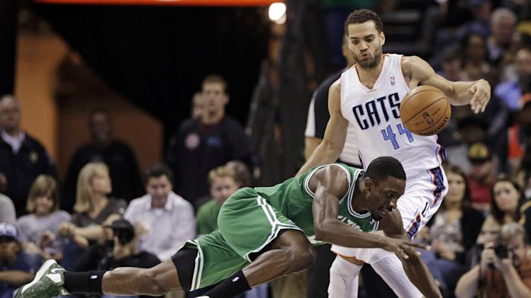 Boston Celtics' Jeff Green, front, falls as he is fouled by Charlotte Bobcats' Jeffery Taylor, rear, during the first half of an NBA basketball game in Charlotte, N.C., Monday, Feb. 11, 2013. (AP Photo/Chuck Burton)