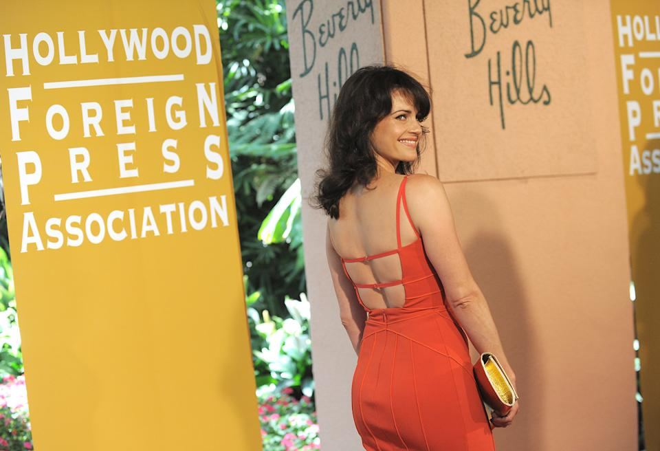 Carla Gugino attends the Hollywood Foreign Press Association luncheon at the Beverly Hills Hotel on Thursday, Aug. 9, 2012, in Beverly Hills, Calif. (Photo by Jordan Strauss/Invision/AP)