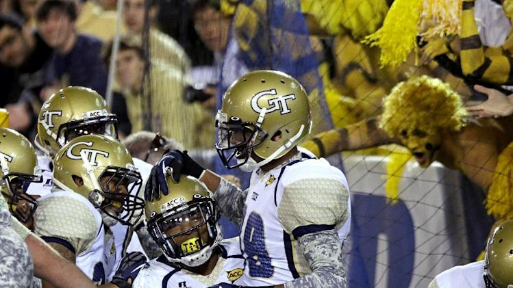 Georgia Tech running back Robert Godhigh, center, is congratulated by teammates after scoring a touchdown in the fourth quarter of an NCAA college football game against Duke, Saturday, Nov. 17, 2012, in Atlanta. Georgia Tech won 42-24. (AP Photo/David Goldman)