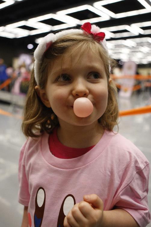 Alex Porter, 6, of Vancouver, Washington practices blowing bubblegum bubbles at Break the World Record with Kirby on Saturday Sept. 1, 2012 at PAX Prime in Seattle.  (Photo by Kevin Casey/Invision for Nintendo of America/AP Images)