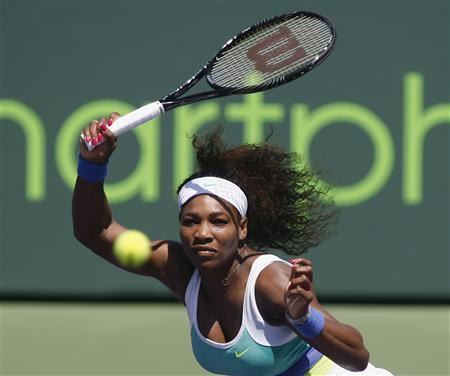 Williams returns a shot to Sharapova in their women's singles final match at the Sony Open tennis tournament in Key Biscayne, Florida